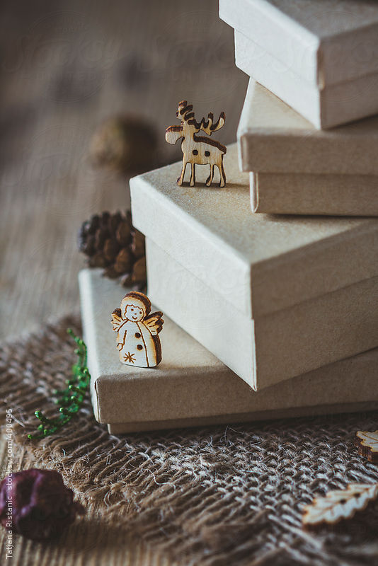 Deer and angel ornament on Christmas gifts by Tatjana Ristanic