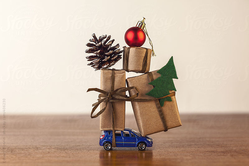 Three Christmas gift boxes on blue toy car. by Eduard Bonnin