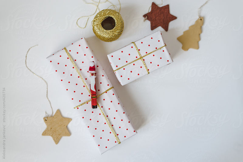 Christmas presents wrapped in polka dot paper on white by Aleksandra Jankovic