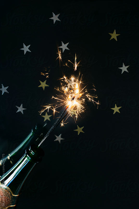 Bottle of champagne with sparkler for celebrating New Year by Beatrix Boros