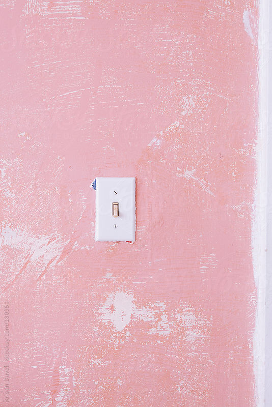 Light switch on pink wall by Kristin Duvall
