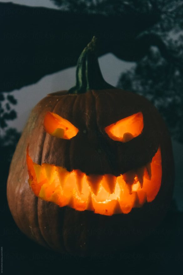Halloween stock photo of a creepy lit jack o'lantern